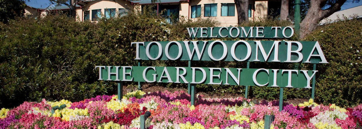 "Image of a sign saying ""Welcome to Toowomba The Garden City"""