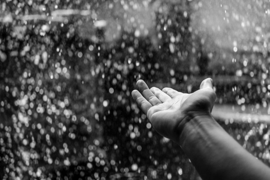 Hand catching rain